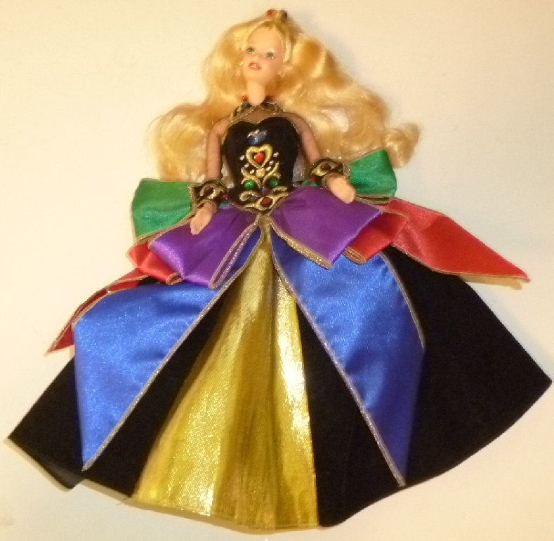 CE BARBIE Doll blonde wearing fancy colorful velvet gown