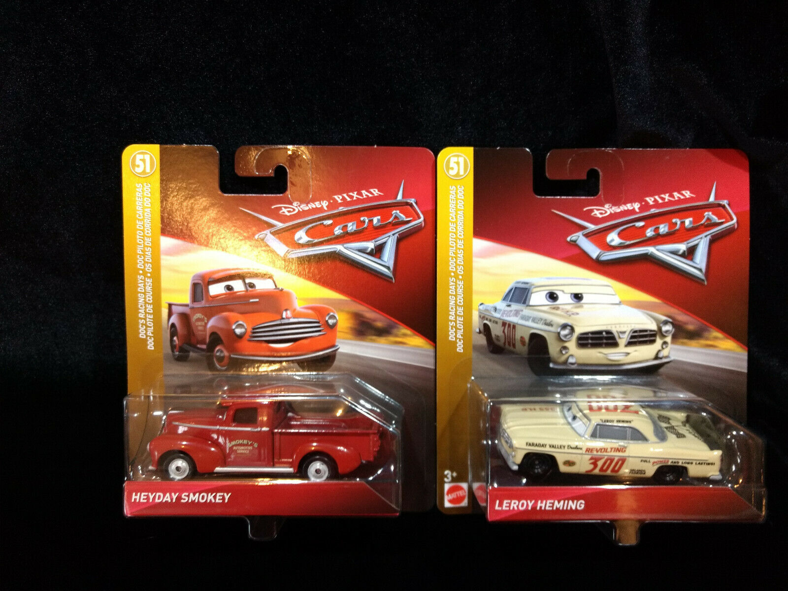 2 New in package Disney Cars Doc's Racing - Heyday Smokey & Leroy Heming