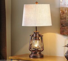 "28"" Bronzed  Iron Lantern Design Table Lamp with Cream Polyester Lamp Shade"