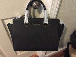 Michael Kors Selma- Black - $200.00