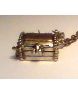 "TREASURE CHEST SHAPED PHOTO LOCKET WITH 27"" CHAIN - $10.00"