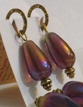 Irridescent Purple glass Silver plated stitch m... - $8.00