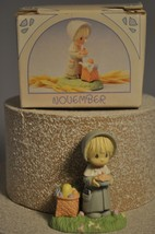 Precious Moments - November - Pilgrim Girl with Pie - 573892 Miniature - $12.02
