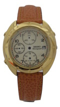 Case with dial and orange leather strap, caliber 7T32 - $158.40