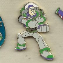 Disney Toy Story Buzz Lightyear stands firing his laser Pin/Pins - $19.33