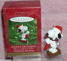 Snoopy holding a stocking to hang Miniature ornament - $16.83