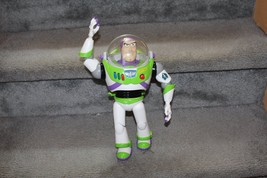 BUZZ LIGHTYEAR 9'' SOUND AND LIGHT- UP - $16.82