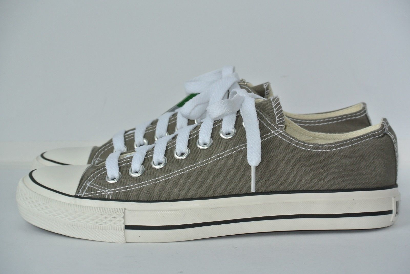 57. 57. Previous. NEW Converse All Star Chuck Taylor Low Top Gray Womens  8.5 Mens 7 Canvas Shoes a5a56dbba