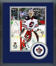 Connor Hellebuyck 2016 NHL Heritage Classic -11x14 Team Logo Matted/Framed Photo - $43.55