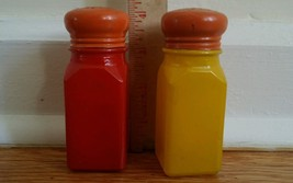 Vintage Anchor Hocking Fired on Red Yellow Glass Salt & Pepper shakers HTF - $19.79