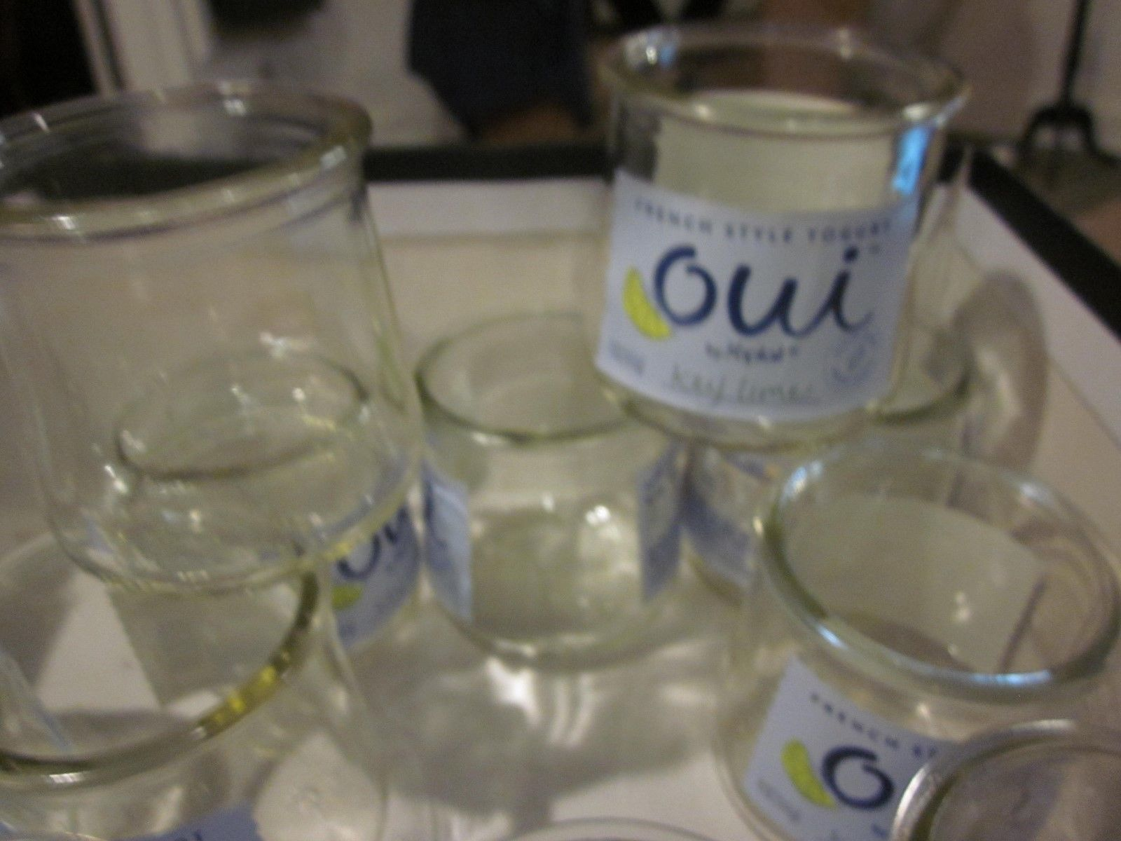 TWELVE 12 OUI EMPTY YOUGUT GLASS JARS GOOD FOR CRAFTS AND CANDLES