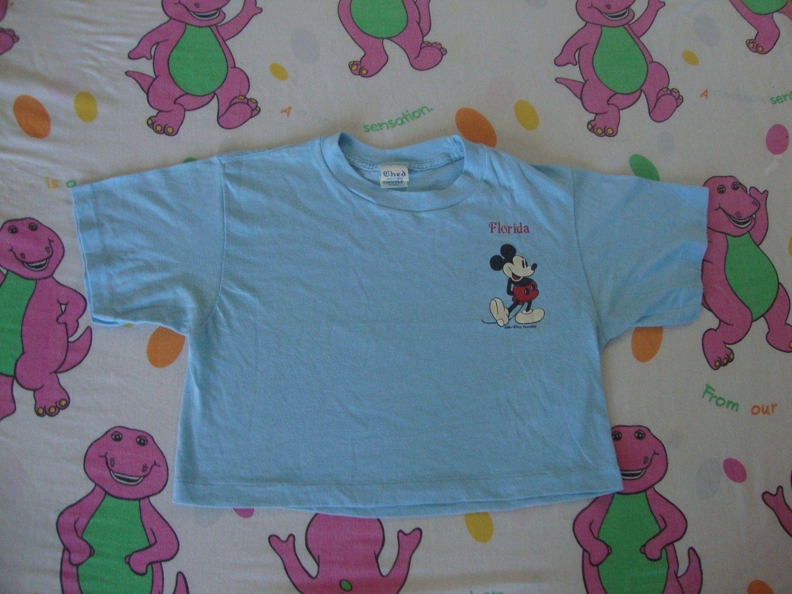 6cbb346f S l1600. S l1600. Previous. Vintage 80's Walt Disney World MICKEY MOUSE  blue 1/2 half belly T shirt Adult
