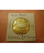 1 GRAM .999 SILVER GUN BAR WITH MINUTE TRACE AMOUNTS OF GOLD FLAKES  - $2.05