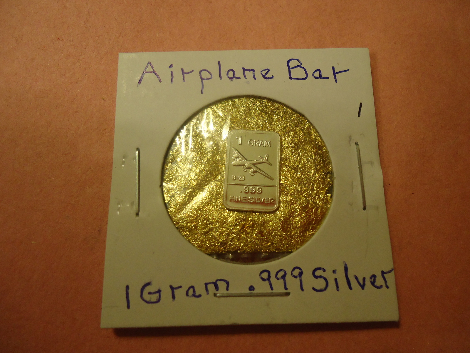 Primary image for 1 GRAM .999 SILVER AIRPLANE BAR WITH MINUTE TRACE AMOUNTS OF GOLD FLAKES