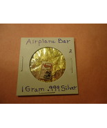 1 GRAM .999 SILVER AIRPLANE BAR WITH MINUTE TRACE AMOUNTS OF GOLD FLAKES  - $2.05