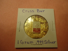 1 GRAM .999 SILVER CROSS BAR WITH MINUTE TRACE AMOUNTS OF GOLD FLAKES  - $2.05