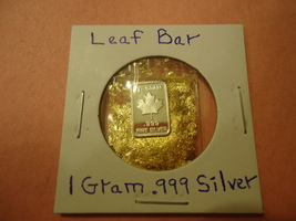 1 GRAM .999 SILVER LEAF BAR WITH MINUTE TRACE AMOUNTS OF GOLD FLAKES  - $2.05