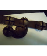5 Vintage Sleigh Bells on pieces of leather - $90.00