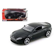 Aston Martin V12 Vantage Black 1/24 Diecast Car Model by Motormax - $31.39