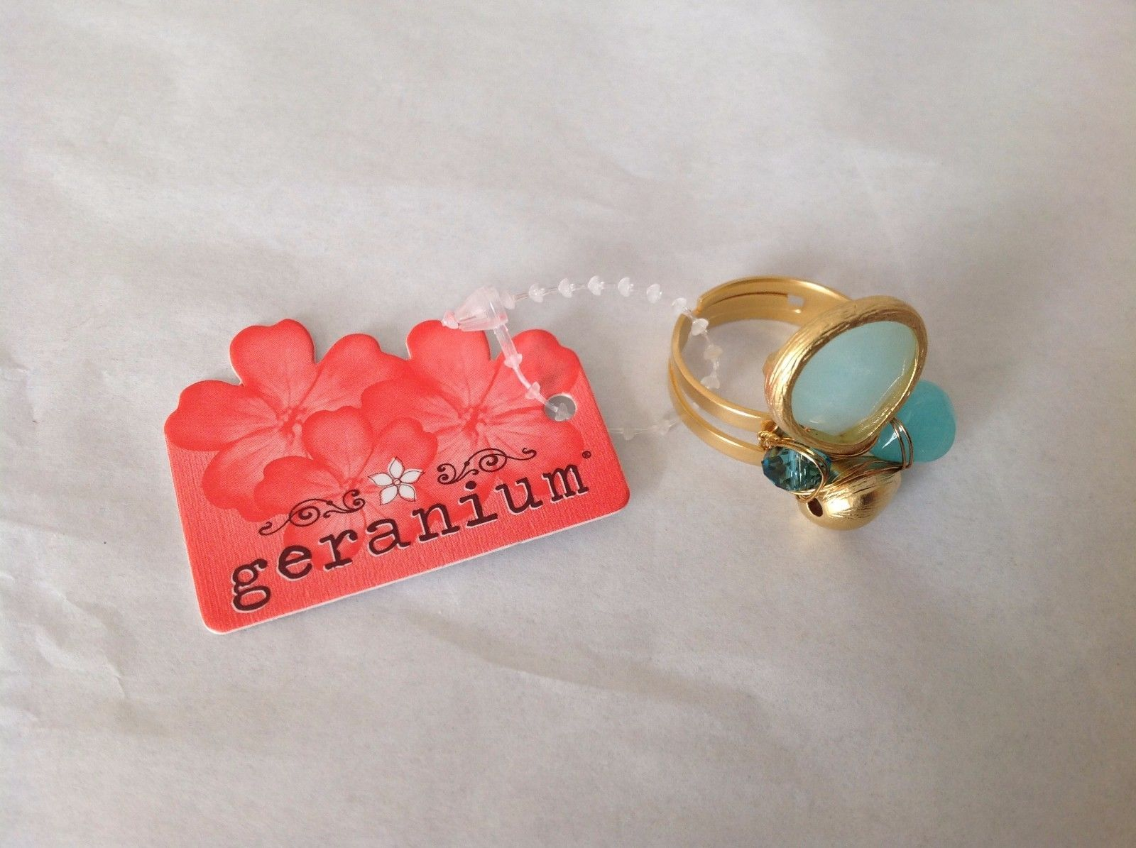 NEW Geranium Gold Toned Ring With Blue Stones NWT Adjustable size 7 +