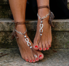 Brown and silver INFINITE BAREFOOT SANDALS with... - $30.00