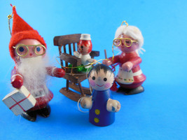 4 Vintage Wooden Christmas Ornaments Mr & Mrs santa Claus baby in rocker & child - $10.93