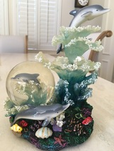 Leaping Dolphins Musical Rotating Snow Globe  - $20.00