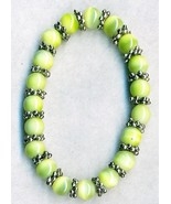 Green Glass Cateye Pewter Elastic Bracelet - $0.99
