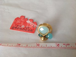 NEW Geranium Gold Toned Ring With Blue Stones NWT Adjustable size 7 + image 5