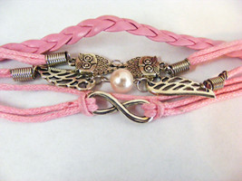 ONE DIRECTION BRIGHT PINK BRAIDED AND CORDED BRACELET TWO OWLS AND WINGS - $5.34