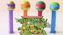 12 Teenage Ninja Turtles Pez, Each With 2 Packs Of 6 Rolls Pez Candy Refills - $26.72