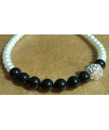 Black and white pearl bracelet with silver wire ball by osborn jewelry featuring gaia s essence  3  thumbtall