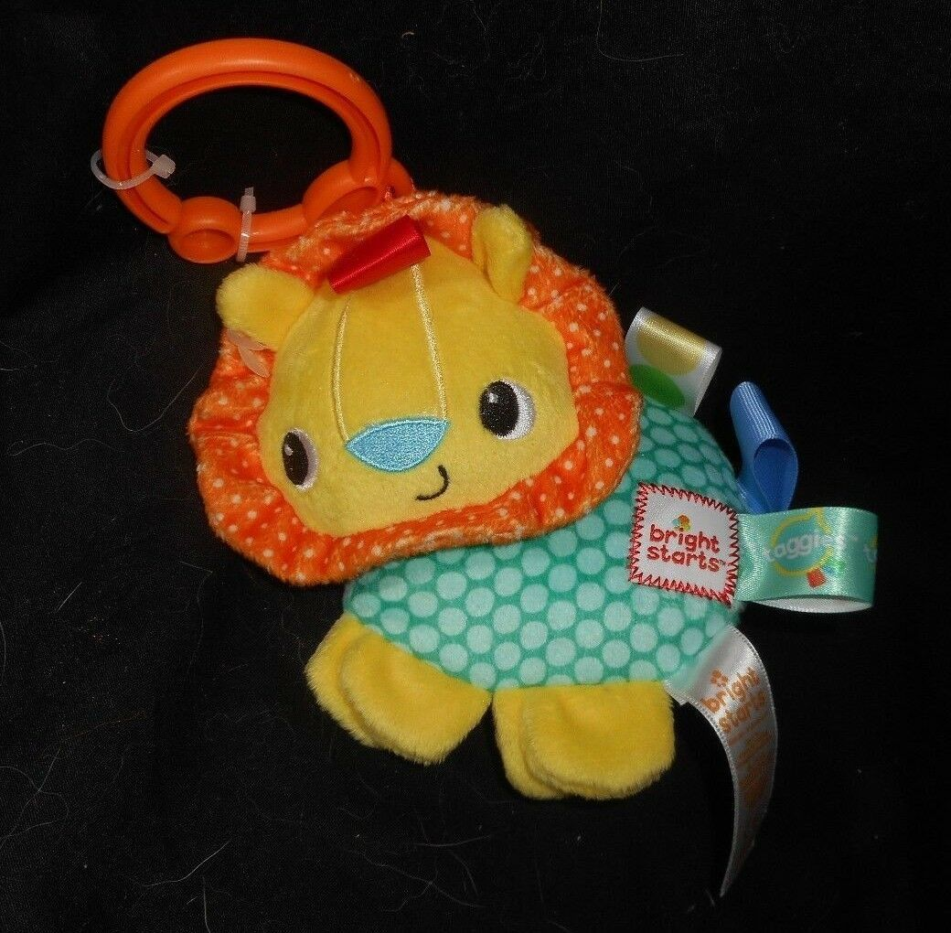 Primary image for NEW TAGGIES BRIGHT STARTS PLAY PALS BABY CLIP LION RATTLE STUFFED ANIMAL PLUSH