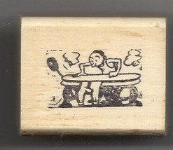 Guy Using an ironing press to iron rubber stamp ab - $13.63