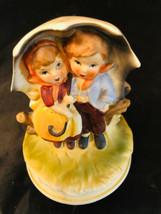 "Porcelain Musical Figurine Japan Boy Girl Umbrella 6-1/2"" High 5"" Diameter - $23.92"