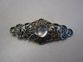 UNMARKED SILVER COLOR BROOCH WITH CLEAR MOONSTONE IN CENTER - $4.94