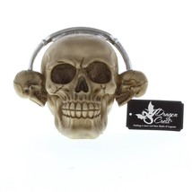 ROCKIN' HEADPHONE SKULL FIGURINE - $14.80