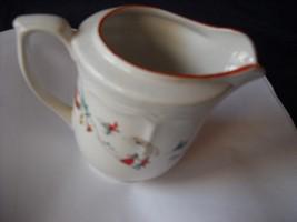 Katherine Babonovsky White Christmas creamer - $13.99
