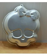 2013 Wilton 2105-6677 Monster high skull with hair bow cake pan - $7.52