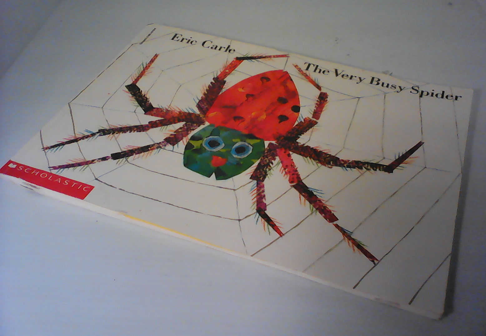 Very Busy Spider/ Eric Carle/ Scholastic paperback/ 1984/ animal book