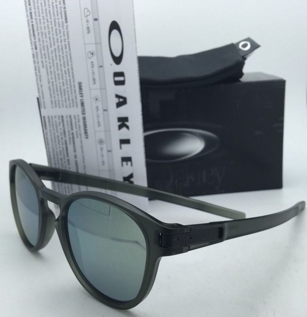 New OAKLEY Latch Sunglasses OO9265-05 Olive Ink Frames w/Emerald Iridium Lenses