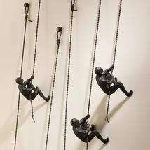 Global Views Man Climbing Rope Iron Metal Wall ... - $96.00