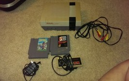 Nintendo NES Console Bundle with two games see details - $106.88