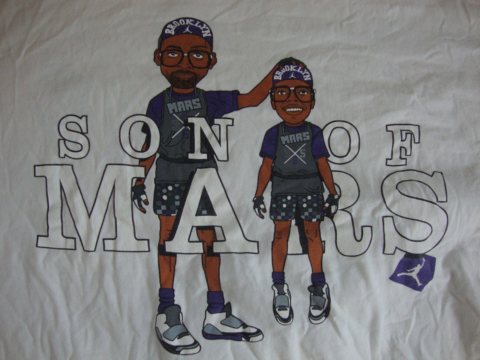 32fc626ca011 S l1600. S l1600. Previous. Michael Jordan Son Of Mars Blackmon Spike Lee  NBA Caricature T Shirt Men s 4XL
