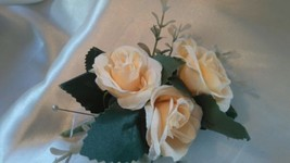 Very pretty soft peach rose cluster corsage.  - $7.21