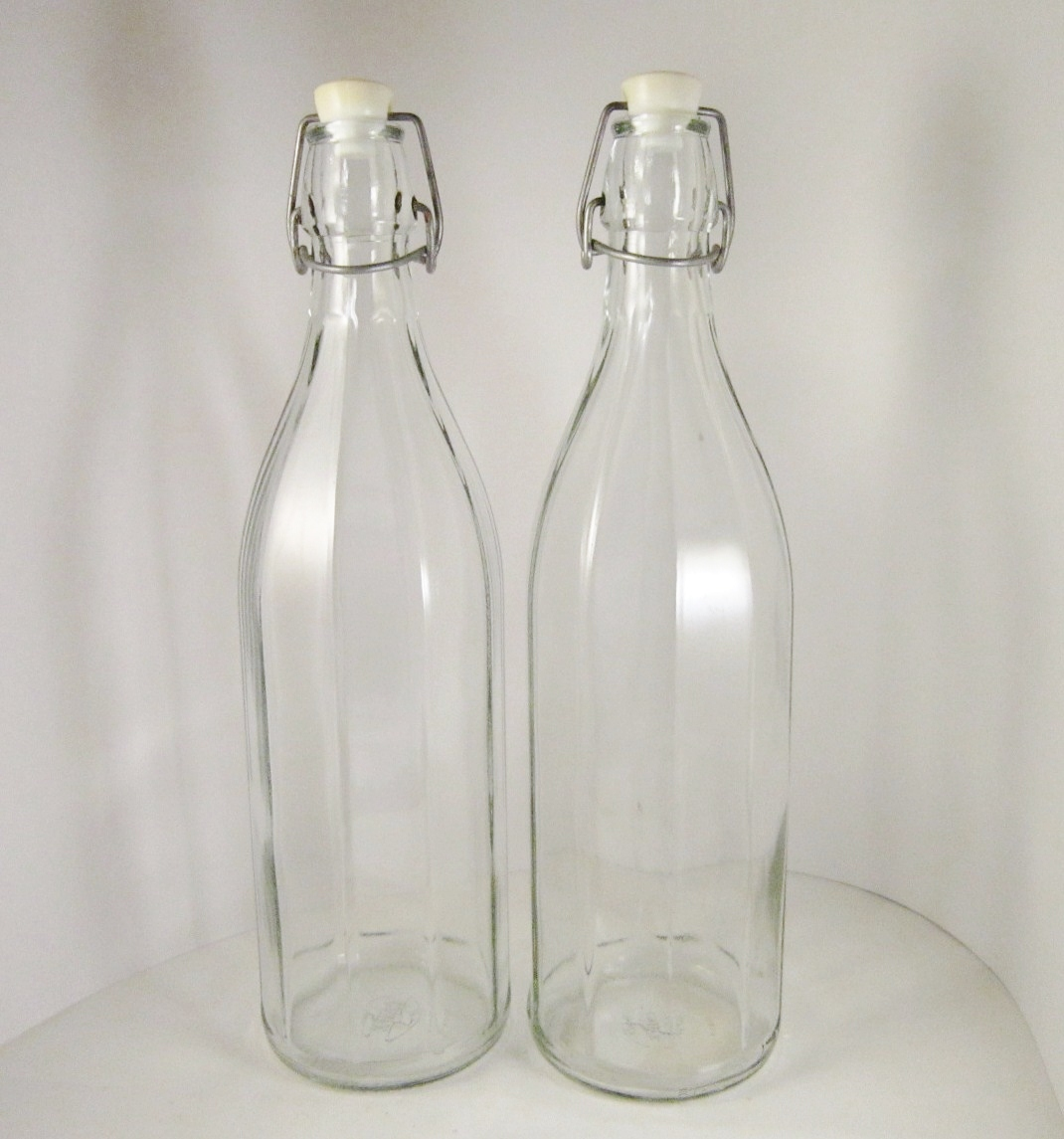 Two Tall Italian Cerve Glass Bottles, Wire Bail and Stopper, Panelled