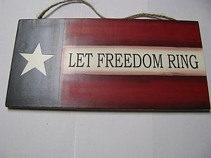 P50-Let Freedom Ring Wood Sign hangs by Jute