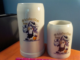 VINTAGE NATO OKTOBERFEST 2006 LOT OF 2  BEER STEIN 32 OZ & 20 OZ .......... - $22.55