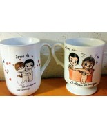 Love Is....Kim Casli Coffee Mugs/ Cups Set of 2 - 1 1972 LA Times George... - $27.20 CAD