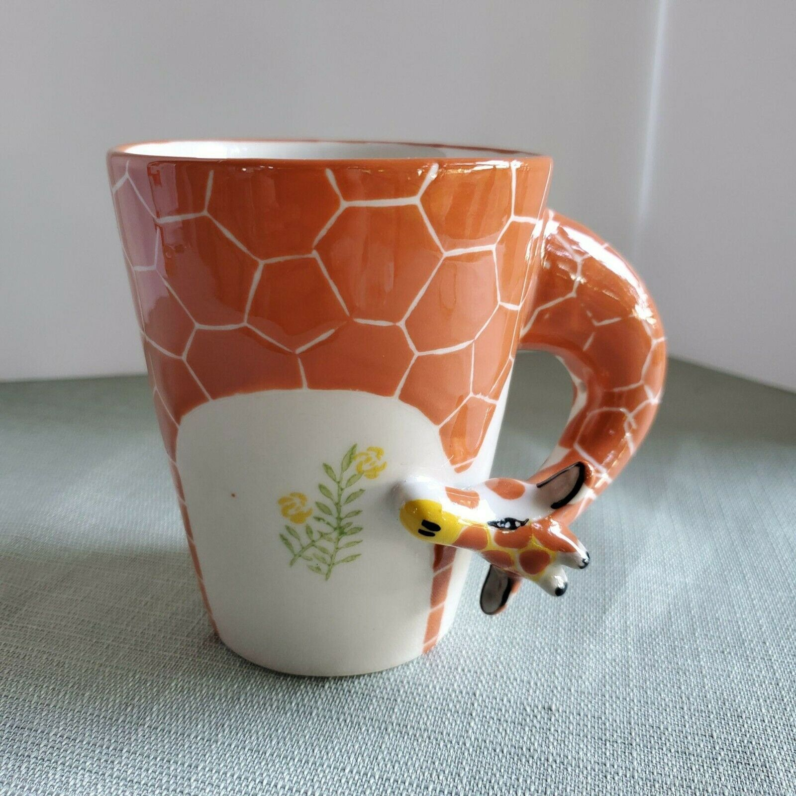 Primary image for Giraffe Mug white and orange with Giraffe head wrap around handle eating yellow